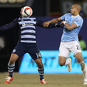 Dom Dwyer, (left), Sporting KC, is challenged by Jason Hernandez, NYCFC, during the New York City FC Vs Sporting Kansas City, MSL regular season football match at Yankee Stadium, The Bronx, New York,  USA. 27th March 2015. Photo Tim Clayton