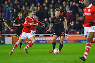 Max Power of Sunderland (27) passes the ball away from Jordan Williams of Barnsley (22) during the EFL Sky Bet League 1 match between Barnsley and Sunderland at Oakwell, Barnsley, England on 12 March 2019.