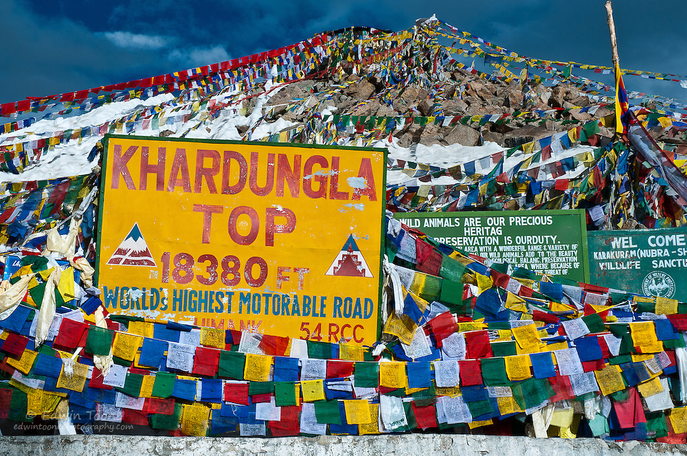 The highest motorable pass in the world covered in prayer flags.