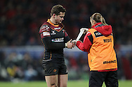 Hallam Amos of the Dragons receives treatment .<br /> Guinness Pro12 rugby match, Munster v Newport Gwent Dragons at Thomond Park in Limerick , Ireland on Saturday 5th March 2016.<br /> pic by  John Halas, Andrew Orchard sports photography.