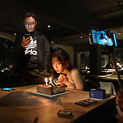 Nai Nai, a 23-year-old live-streamer in Shanghai, blows out the candles on her birthday cake as her male fans who were attending her party watch her on their smartphones. Nai Nai's fans are mostly Chinese men between 15 and 30 years old who post messages and virtual gifts, visible to everyone logged on to her chatroom. China's livestreaming industry reached 425 million subscribers in 2018 out of a current total internet user base of more than 829 million, according to government statistics cited in Chinese state media. Livestream hosting is an increasingly popular career choice, especially for young Chinese women like Nai Nai.