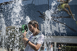 MELBOURNE, Jan. 24, 2019  A spectator plays at a fountain during the 2019 Australian Open in Melbourne, Australia, on Jan. 24, 2019. The Melbourne Park witnessed hot weather here on Thursday. (Credit Image: © Lui Siu Wai/Xinhua via ZUMA Wire)