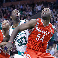 06 March 2012:  Boston Celtics power forward Brandon Bass (30) vies for the rebound with Houston Rockets power forward Patrick Patterson (54) and Houston Rockets point guard Kyle Lowry (7) during the Boston Celtics 97-92 (OT) victory over the Houston Rockets at the TD Garden, Boston, Massachusetts, USA.