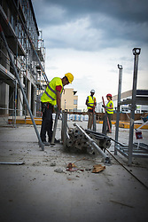 Construction workers working at building site, Munich, Bavaria, Germany