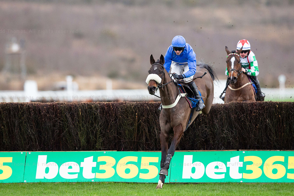 Ffos Las Racecourse, Trimsaran, Wales, UK. Monday 14 January 2019. The Last Day (jockey Adam Wedge) (L) jumps in the Prince Fluffy Kareem Novices' Chase (Race 3)