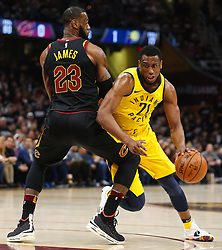 April 18, 2018 - Cleveland, OH, USA - The Indiana Pacers' Thaddeus Young, right, gets past the Cleveland Cavaliers' LeBron James in the first quarter of Game 2 of a first-round NBA playoff series on Wednesday, April 18, 2018, at the Quicken Loans Arena in Cleveland. (Credit Image: © Leah Klafczynski/TNS via ZUMA Wire)