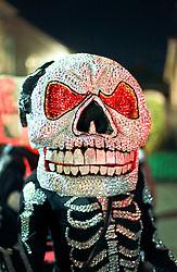 13 Feb 2015. New Orleans, Louisiana.<br /> Mardi Gras. A member of the Skeleton Krewe makes her way along Magazine Street as the Krewe D'Etat rolls.<br /> Photo; Charlie Varley/varleypix.com