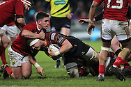 Ed Jackson of the Dragons is stopped by Ian Keatley of Munster .Guinness Pro12 rugby match, Munster v Newport Gwent Dragons at Thomond Park in Limerick , Ireland on Saturday 5th March 2016.<br /> pic by  John Halas, Andrew Orchard sports photography.