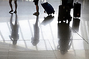 airport terminal with people waiting and walking