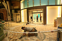 Oasis of the Seas at the shipyard in Turku, Finland where she is being built..Photos show Royal Caribbean's latest  ship 2 months before completion. .Tiling the floor of The Royal Promenade.
