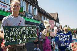Environmental activists from groups opposed to the HS2 high-speed rail link restage a historical 1602 visit by Queen Elizabeth I to Dews Farm on 31st July 2020 in Harefield, United Kingdom. The activists tried to retrace the steps of Queen Elizabeth I from St Mary's church to Dews Farm in order to pay their respects to Anne and Ron Ryall, 73 and 72, on the day of their eviction from Dews Farm by HS2 after having spent nine years and their life savings renovating their £1m dream home, but found their path blocked by HS2 fences and security guards.