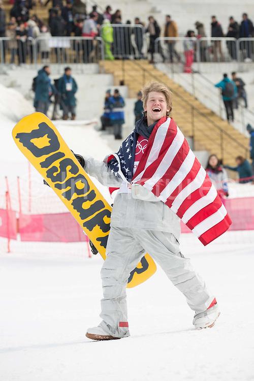 Kyle Mack, USA, BRONZE,  at the mens snowboard big air flower ceremony at the Pyeongchang 2018 Winter Olympics on 24th February 2018, at the Alpensia Ski Jumping Centre in Pyeongchang-gun, South Korea
