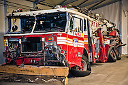 One of the  destroyed emergency response vehicles that are part of a collection of artifacts saved from the site of the World Trade Center after 9/11. Artifacts chosen by curators out of the wreckage  from the World trade Center  stored temporarily within an 80,000 square foot hanger at JFK airport, Hanger 17. Some of the artifacts will be in the National September 11 Memorial Museum set to open in 2012.
