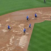 Ground staff treating the infield between innings during rain in the New York Mets Vs Cincinnati Reds MLB regular season baseball game at Citi Field, Queens, New York. USA. 27th June 2015. Photo Tim Clayton