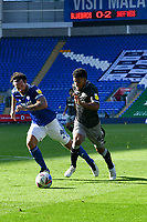 Football - 2020 / 2021- Championship -Cardiff City vs Sheffield Wednesday<br />      <br /> Elias Kachunga of Sheffield Wednesday shoots at goal chased by Sean Morrison of Cardiff Cit, scoreboard n background<br /> in a match played without fans at the Cardiff City Stadium.<br /> <br /> COLORSPORT/WINSTON BYNORTH