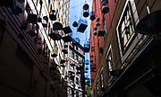 An art installation of 50 hanging cages, titled Forgotten Songs.These hanging cages are suspended in Mid-Air surrounded by Art-Deco buildings in a narrow laneway in the heart of Sydney's CBD. They commemorate the songs of fifty birds once heard in Central Sydney, before they were forced out by European settlement.