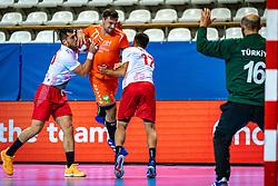 The Dutch handball player Dani Baijens, Gorkem Bicer in action during the European Championship qualifying match against Turkey in the Topsport Center Almere.