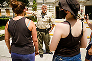 10 JULY 2020 - DES MOINES, IOWA: Polk County Sheriff's Department Captain VANHOOZER tells members of Black Lives Matter to leave the front of the Polk County Courthouse. About 75 people, members and supporters of Black Lives Matter gathered at the Polk County Courthouse to protest law enforcement harassment of Black Lives Matter. They also showed support for several members of BLM who made their first appearance in court following their arrest at a BLM protest last week. BLM has become very active in Des Moines in the wake of the police killing of George Floyd in Minneapolis in May.      PHOTO BY JACK KURTZ