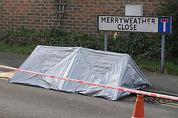© Licensed to London News Pictures.13/02/2013. Dartford. Kent. A 32 year old man has been shot dead in Dartford last night (12/02/2013). The police have set up a cordon in Merryweather Close this morning.The victim has been named locally as Kevin Mckinley from Stone. Police have arrested a man and woman.People have been arriving at the scene to lay flowers. Photo credit : Grant Falvey/LNP