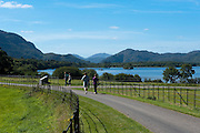 Walkers take a stroll by Lough Lein, Killarney's Lower Lake on a trip around the Muckross Demesne in Killarney National Park.<br /> Picture by Don MacMonagle
