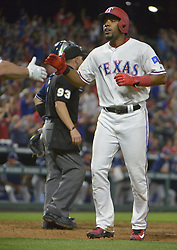 May 11, 2017 - Arlington, TX, USA - The Texas Rangers' Elvis Andrus scores the game-tying run during the ninth inning against the San Diego Padres at Globe Life Park in Arlington, Texas, on Thursday, May 11, 2017. The Rangers won, 5-2. (Credit Image: © Max Faulkner/TNS via ZUMA Wire)