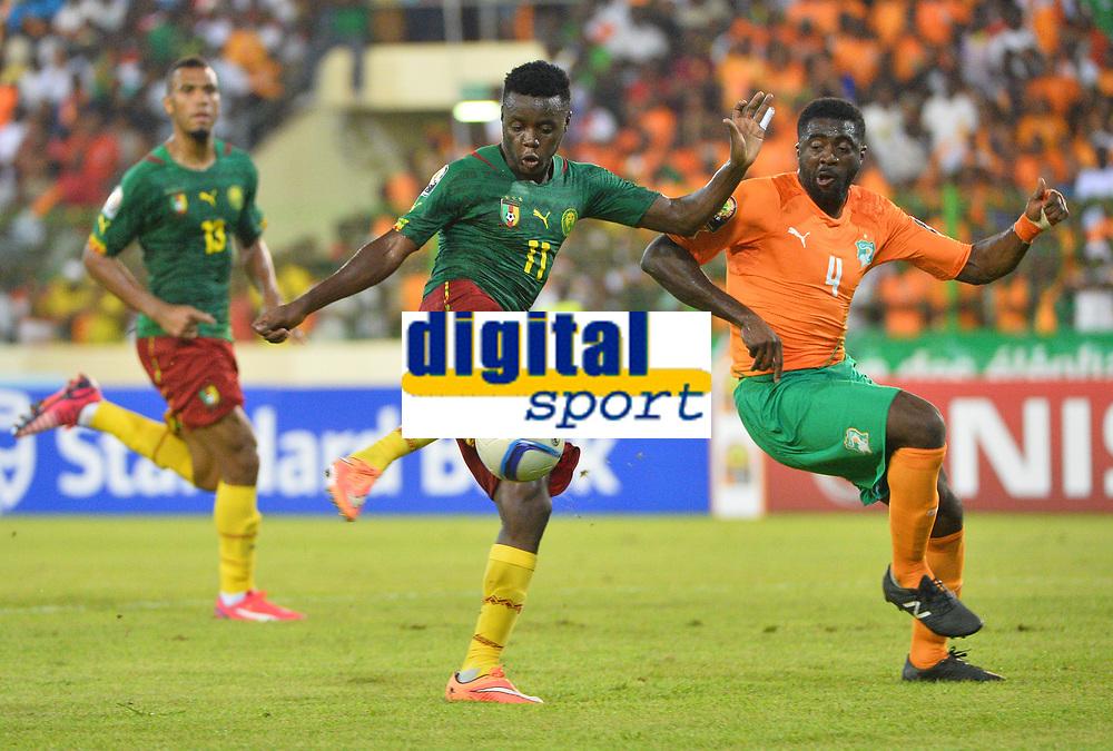 Edgar Salli ( Cameroun - Kolo Toure ( Cote Ivoire )