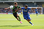 AFC Wimbledon striker Andy Barcham (17) battles for possession with Doncaster Rovers midfielder Nial Mason (8) during the EFL Sky Bet League 1 match between AFC Wimbledon and Doncaster Rovers at the Cherry Red Records Stadium, Kingston, England on 26 August 2017. Photo by Matthew Redman.