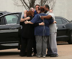April 3, 2017 - St. Louis, Missouri, U.S. - People comfort each other at the scene of a reported boiler explosion on Monday in an industrial area. The explosion occurred at the Loy-Lange Box Company at 222 Russell Blvd. (Credit Image: © Laurie Skrivan/TNS via ZUMA Wire)
