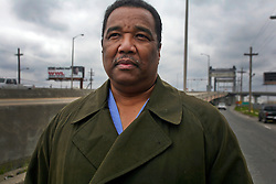 02 March 2010. New Orleans, Louisiana, USA. <br /> Civil Rights leaders gather at the notorious Danziger Bridge in New Orleans East, scene of the Sunday Sept 4th, 2005 murder of 40 yr old Ronald Madison and 19 yr old James Brissette by New Orleans police. <br /> Doctor Romell Madison, brother of victim Ronald Madison  revisits the scene of his brother's death.<br /> The police are under federal investigation for an alleged cover up of the botched killings in the chaotic aftermath of hurricane Katrina. <br /> Photo; Charlie Varley.