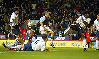 Photograph: Scott Heavey.<br /> Aston Villa v Portsmouth. FA Barclaycard Premiership. 06/01/2003.<br /> The ball flies around the penalty box before deflecting in for the winner