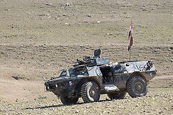 Licensed to London News Pictures. 20/02/2017. Albu Saif, Iraq. An Iraqi Federal Police officer takes a break in an M117 armoured security vehicle as his unit prepares to advance on the village of Albu Saif as part of the offensive to retake western Mosul from the Islamic State.<br /> <br /> The settlement of Albu Saif is located on high ground overlooking Mosul Airport and as such is a strategic point that needs to be taken as part of the operation to retake the western side of Mosul. Photo credit: Matt Cetti-Roberts/LNP