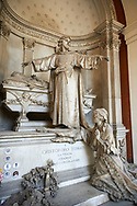 Picture and image of the stone sculpture of Christ standing arms outstretched by the sacophagus of the deceased whilst his wife prays on the steps of the tomb. Sculpted in a Borgeoise Realistic style by GB Villa in 1881. The Tomati family tomb, section D no 12, the  monumental tombs of the Staglieno Monumental Cemetery, Genoa, Italy .<br /> <br /> Visit our ITALY PHOTO COLLECTION for more   photos of Italy to download or buy as prints https://funkystock.photoshelter.com/gallery-collection/2b-Pictures-Images-of-Italy-Photos-of-Italian-Historic-Landmark-Sites/C0000qxA2zGFjd_k<br /> If you prefer to buy from our ALAMY PHOTO LIBRARY  Collection visit : https://www.alamy.com/portfolio/paul-williams-funkystock/camposanto-di-staglieno-cemetery-genoa.html