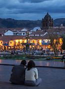 Couple overlooking the Plaza de Armas, Cusco, Peru, South America