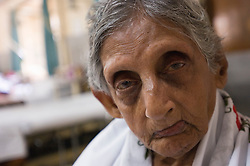 RAWALPINDI, PAKISTAN - NOV-01-2006 - An elderly woman is cared for at the St. Joseph Hospice. The hospice was started by Father Francis O'Leary, an Irish missionary, in 1964. Franciscan nuns of the Missionaries of Mary, run the hospice and have a fully trained staff of 26 Pakistani nurses aides and volunteer doctors. The hospice, orphanage and free clinic has 60 beds for resident patients and treats 80-90 out patients daily.  St. Joseph is supported solely by donations.   (PHOTO © JOCK FISTICK)