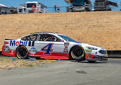June 22, 2018 - Sonoma, CA, U.S. - SONOMA, CA - JUNE 22:  Kevin Harvick, driving the (4) Ford for Stewart-Haas Racing lifts off on turn 8 on Friday, June 22, 2018 at the Toyota/Save Mart 350 Practice day at Sonoma Raceway, Sonoma, CA (Photo by Douglas Stringer/Icon Sportswire) (Credit Image: © Douglas Stringer/Icon SMI via ZUMA Press)