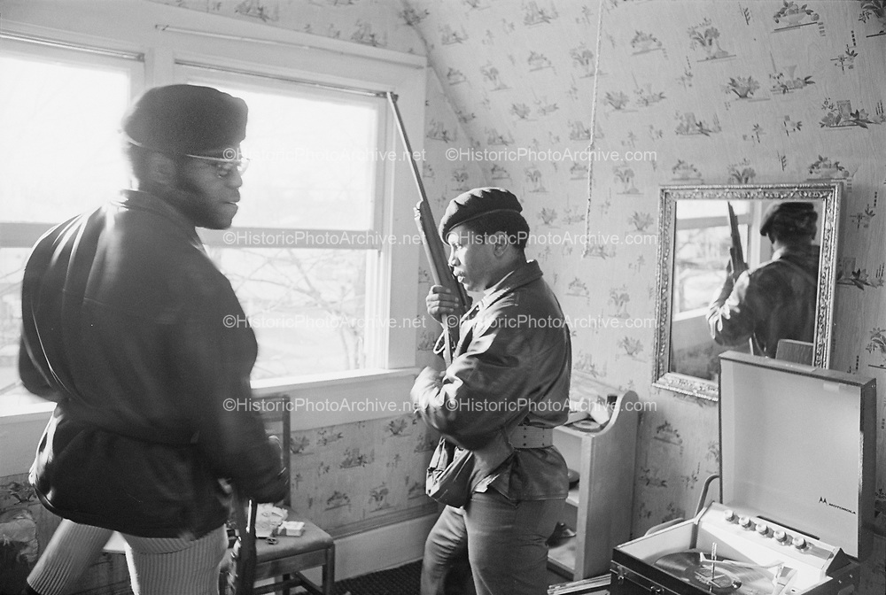 1006-B030-06. Eugene Black Panthers at their heavily fortified headquarters on 13th & Hilyard. Eugene Police had engaged them in a brief firefight while attempting to serve a warrant for their leaders, Howard and Tommy Anderson. The conflict ended when a Eugene attorney, Ken Morrow, negotiated with a judge and got permission to bring the two Panthers to City Hall, where he bailed them out and retuned them within one hour. March 1969