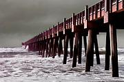 Hurricane in the Gulf of Mexico sends waves crashing into the Pier at Pensacola Beach, Florida.