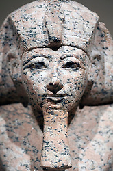 Kneeling figure of Queen Hatshepsut with cultic vessel at Neues Museum or New Museum on Museumsinsel or Museum Island in Berlin