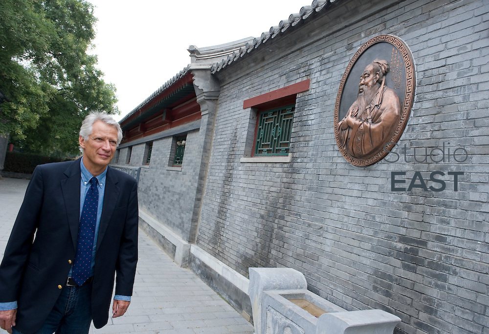EXCLUSIVE. Former French Prime Minister Dominique de Villepin takes a stroll in a centuries-old hutong, or traditional street, in front of the Temple of Confucius (represented on the wall), in Beijing, China, on August 31, 2010. Hutongs are traditional streets sometimes dating back to the foundation on Beijing. The Temple of Confucius dates back to 1302. Dominique de Villepin is in China for a 6-day visit. He will inaugurate an engraving of one of his poem both in Chinese and French in a park, and take part in the World Emerging Industries Summit, and the North-East Asia trade Exposition. Exclusive Photo by Lucas Schifres/Pictobank
