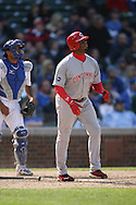 CHICAGO - APRIL 17:  Ken Griffey Jr. #3 of the Cincinnati Reds watches the flight of his 596th career home run during the game against the Chicago Cubs at Wrigley Field in Chicago, Illinois on April 17, 2008.  The Reds defeated the Cubs 8-2.  (Photo by Ron Vesely)