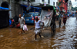 August 1, 2018 - Kolkata, India - Kolkata streets are merged with water due to poor drainage system after the heavy rain. (Credit Image: © Avishek Das/Pacific Press via ZUMA Wire)