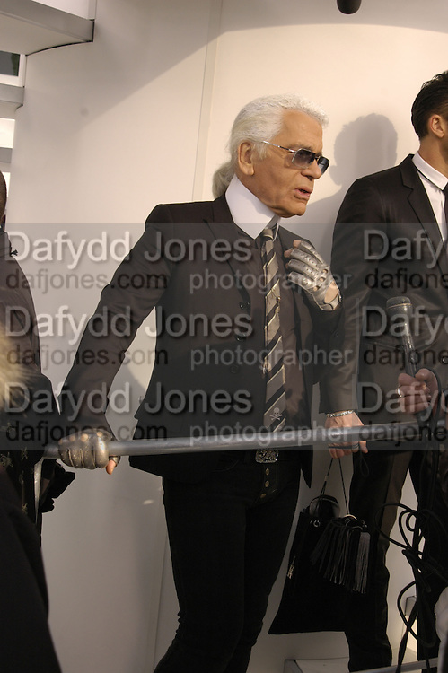 Karl Largerfeld. Chanel couture fashion show. Grand Palais, Ave Winston Churchill. Paris. 24  January  2006.  ONE TIME USE ONLY - DO NOT ARCHIVE  © Copyright Photograph by Dafydd Jones 66 Stockwell Park Rd. London SW9 0DA Tel 020 7733 0108 www.dafjones.com