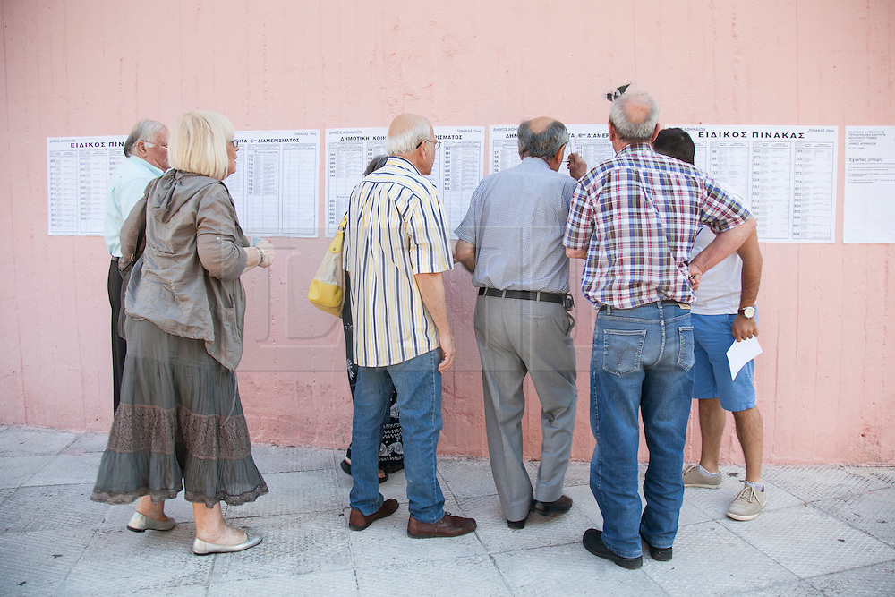 © London News Pictures. 05/07/2015. members of the Greek public casting their votes at a voting centre in Athens, Greece on the day that a referendum is held on a financial bailout for the country. Photo credit: Katerina Kotti/LNP