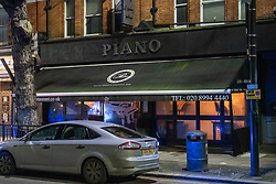 © Licensed to London News Pictures. 29/01/2021. London, UK. An unmarked police vehicle outside the Piano Restaurant in Chiswick. Police were called to the Piano Restaurant on Chiswick High Road on the evening of Friday 29th after reports of a large gathering. Police forced entry through a rear door which lead to many at the gathering to flee through the main entrance at the front of the restaurant. A number of people were detained for a short period including one person held in a police van. Photo credit: Peter Manning/LNP