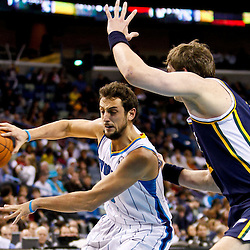December 17, 2010; New Orleans, LA, USA; New Orleans Hornets shooting guard Marco Belinelli (8) passes off the ball as Utah Jazz center Kyrylo Fesenko (44) defends during the second half at the New Orleans Arena.  The Hornets defeated the Jazz 100-71. Mandatory Credit: Derick E. Hingle