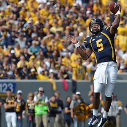 Oct 4, 2008; Morgantown, WV, USA; West Virginia senior quarterback Pat White leaps and throws a pass during the first half of the Mountaineer's 24-17 victory over the Rutgers Scarlet Knights.