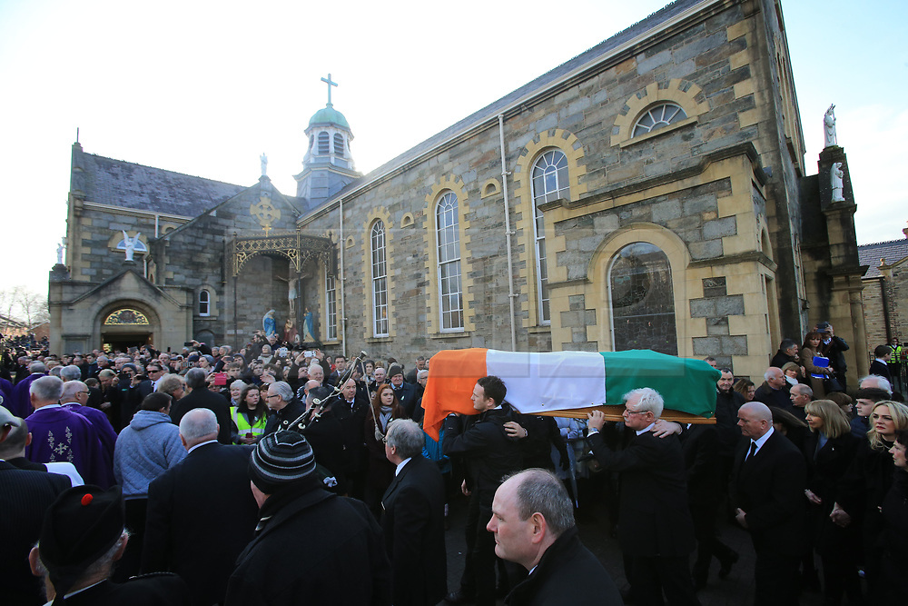 © Licensed to London News Pictures. 23/03/2017. Londonderry, UK. The coffin of Martin McGuinness is carried outside of St Columba's Church in Londonderry, Northern Ireland 23 March, 2017 during the funeral of Sinn Féin's Martin McGuinness. Mr McGuinness, a former IRA leader turned politician, died on Tuesday.. Photo credit: LNP