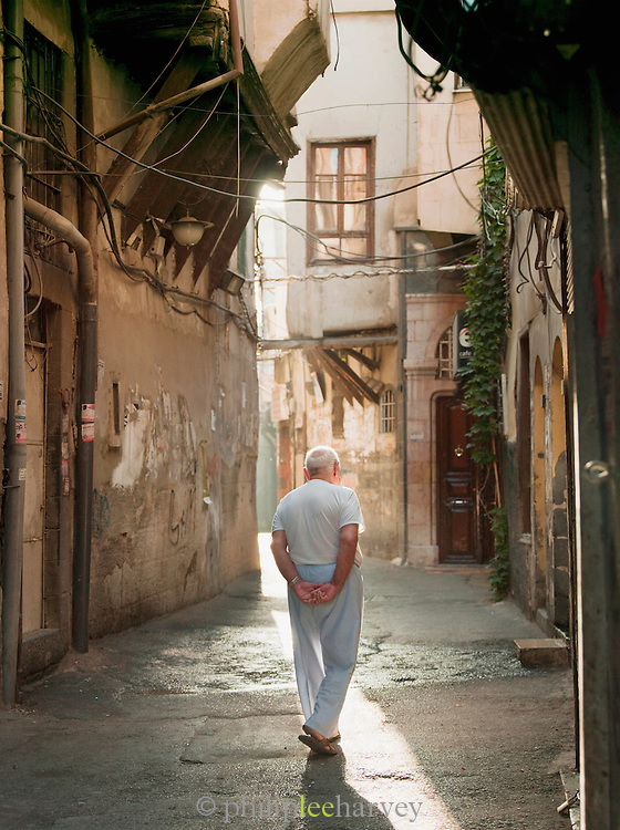 A man walks through the quiets streets in the morning, in the Christian quarter of Damascus, Syria