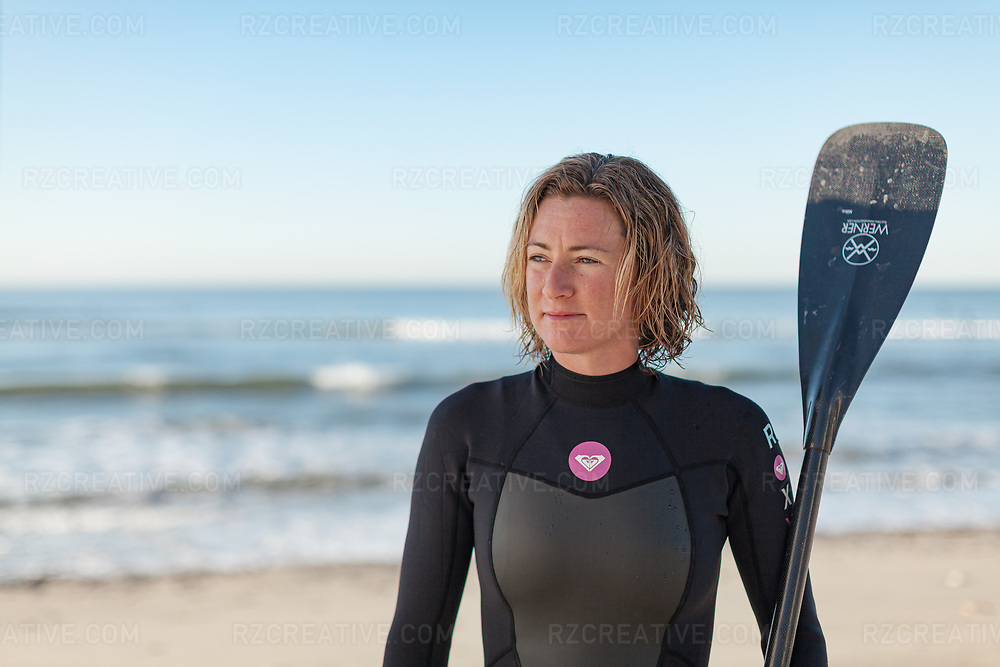 Portait of standup paddler Nikki Gregg at San Onofre State Beach. Photo © Robert Zaleski / rzcreative.com<br /> —<br /> To license this image contact: robert@rzcreative.com