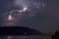 Newburgh, New York - Lightning illuminates the sky above the Hudson River in a view looking south from Bay View Terrace on July 4, 2012. ©Tom Bushey / The Image Works